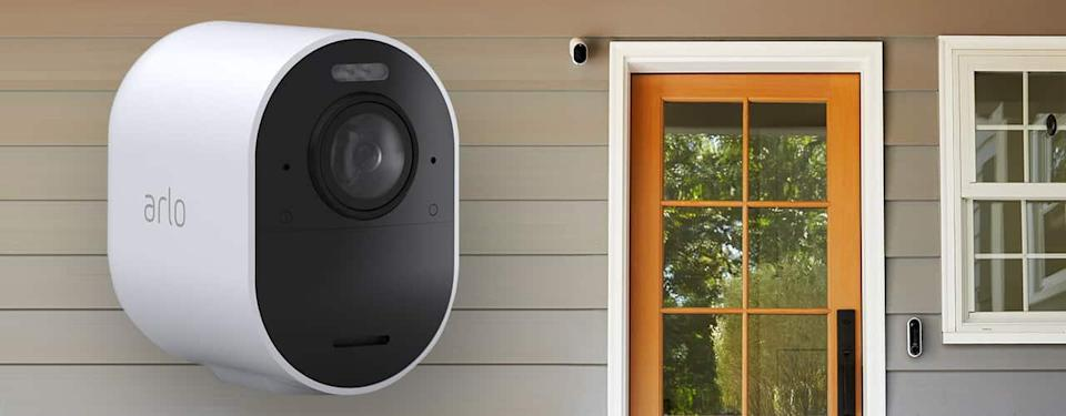 arlo ultra 2 camera for outside your home product shot on on sunny day on side of house background