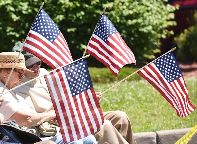 American flags wave during the Utica Fourth of July parade Tuesday, July 4, 2017.
