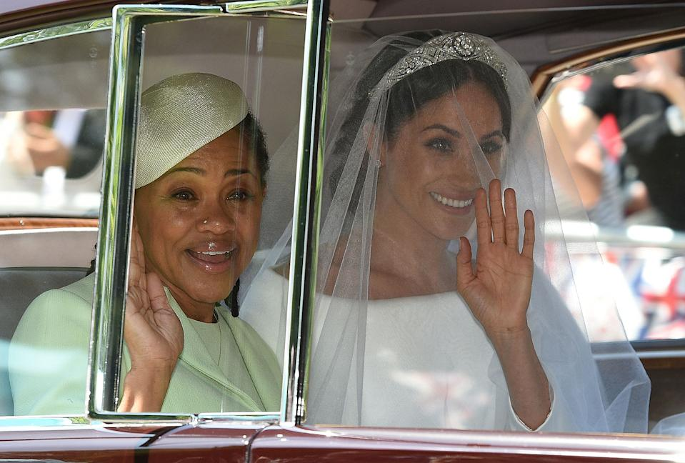 <p>Meghan arrived with her mother, Doria Ragland, for the ceremony. (Oli Scarff/AFP)</p>