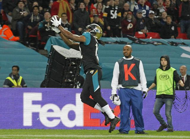 Jacksonville Jaguars wide receiver Mike Brown (12) catches the ball before scoring a touchdown during the NFL football game between San Francisco 49ers and Jacksonville Jaguars at Wembley Stadium in London, Sunday, Oct. 27, 2013. (AP Photo/Sang Tan)