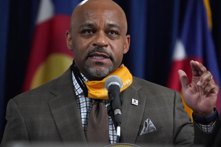 FILE - In this Nov. 17, 2020 file photo Denver Mayor Michael Hancock makes a point during a news conference in Denver. A number of American political leaders have been caught preaching one thing on the coronavirus and doing another. Hancock flew to Mississippi to spend Thanksgiving with his family after urging others to stay home. He later said he was thinking with