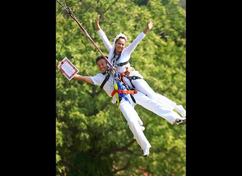 On Feb. 14, 2009, a couple in Thailand took a leap of faith into wedded bliss -- literally. Here, Kunanan Jantri proudly holds his new bride and their marriage certificate while having their wedding ceremony in midair. In an eastern province of Thailand, it's become tradition for couples to rappel off cliffs on Valentine's Day.