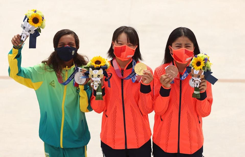 TOKYO, JAPAN - JULY 26:  (L-R) Rayssa Leal of Team Brazil, winner of the silver medal, and Momiji Nishiya, winner of the gold medal, and Funa Nakayama, winner of the bronze medal, of Team Japan pose with their medals during the Women's Street Final medal ceremony on day three of the Tokyo 2020 Olympic Games at Ariake Urban Sports Park on July 26, 2021 in Tokyo, Japan. (Photo by Ezra Shaw/Getty Images)