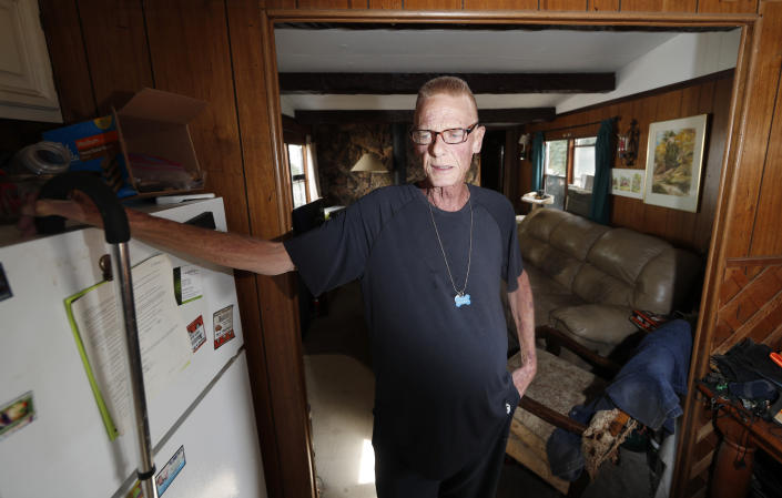 Neil Mahoney is shown inside his trailer home located in a park just below the westbound lanes of Interstate 70 Wednesday, Sept. 4, 2019, in Golden, Colo. Mahoney, who is dying of cancer, has joined forces with his doctor to say that a Colorado hospital's policy barring the doctor from administering life-ending drugs to Mahoney at his home goes against the state's assisted suicide law. (AP Photo/David Zalubowski)