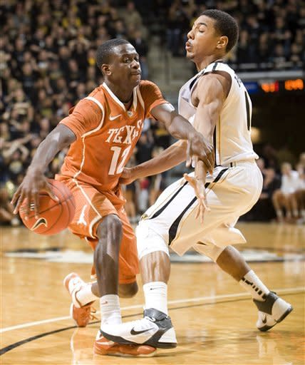 Missouri's Phil Pressey, right, steps on the foot of Texas' Myck Kabongo, left, as he tries to dribble toward the basket during the first half of an NCAA college basketball game Saturday, Jan. 14, 2012, in Columbia, Mo. Missouri won the game 84-73. (AP Photo/L.G. Patterson)
