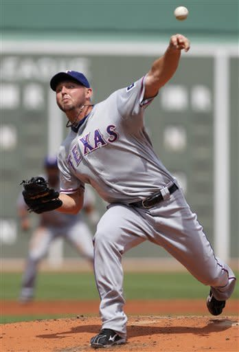 Texas Rangers' Matt Harrison delivers a pitch against the Boston Red Sox in the first inning of a baseball game at Fenway Park in Boston, Wednesday, Aug. 8, 2012. (AP Photo/Steven Senne)