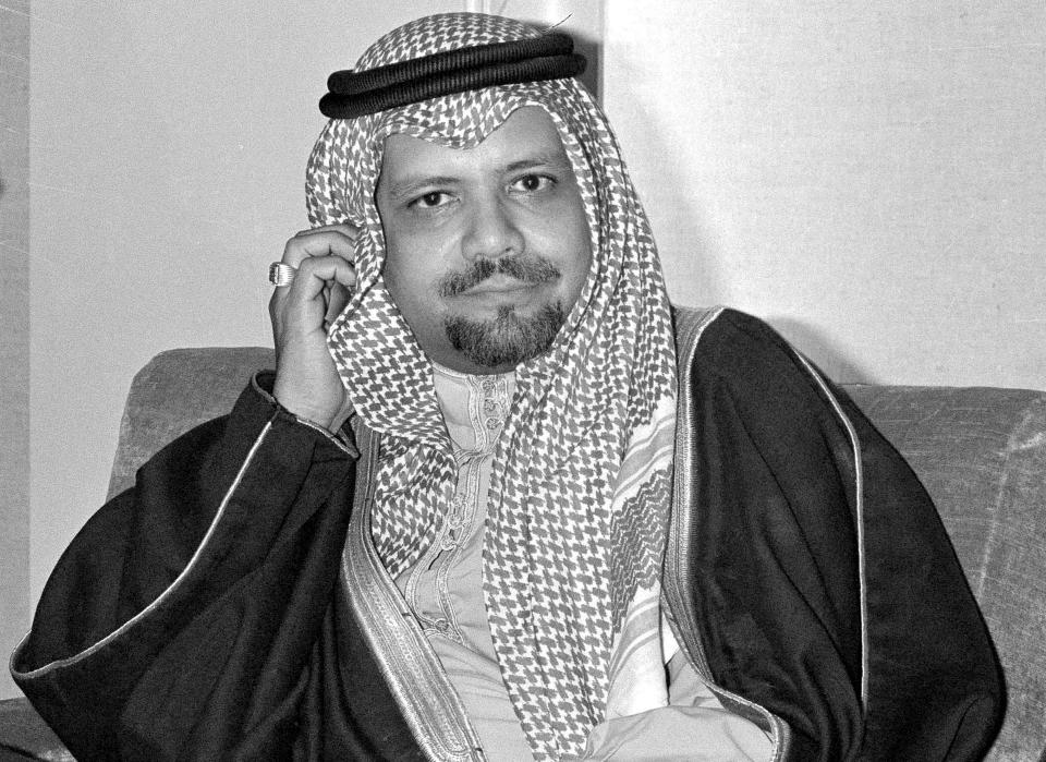 FILE - In this Dec. 14, 1976, file photo, Saudi Oil Minister Ahmed Zaki Yamani listens to newsmen's questions during a news conference at Doha, Qatar, after he arrived to attend OPEC meeting. Yamani, a long-serving oil minister in Saudi Arabia who led the kingdom through the 1973 oil crisis, the nationalization its state energy company and later found himself kidnapped by the assassin Carlos the Jackal, died Tuesday, Feb. 23, 2021, in London. He was 90. (AP Photo, File)