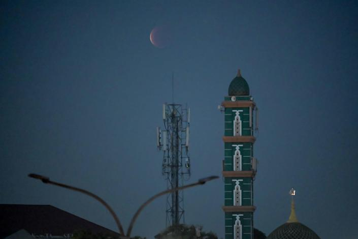 Photo of the moon over Jakarta on May 26, 2021 during a total lunar eclipse / credit: BAY ISMOYO/AFP via Getty Images.