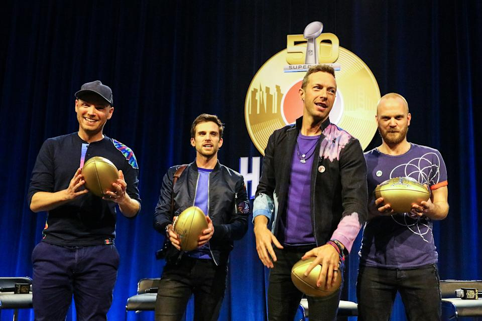 04 FEB 2016: ColdPlay Band members from left to right Jonny Buckland, Guy Berryman Chris Martin and Will Champion pose with Gold Super Bowl 50 Footballs at the Super Bowl 50 Halftime Show press conference at the Moscone Center in San Francisco California. (Photo by Rich Graessle/Icon Sportswire) (Photo by Rich Graessle/Icon Sportswire/Corbis/Icon Sportswire via Getty Images)