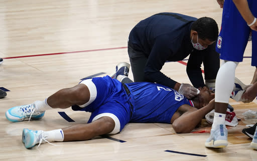 Los Angeles Clippers forward Kawhi Leonard lies on the court after suffering an injury during the second half of the team's NBA basketball game against the Denver Nuggets on Friday, Dec. 25, 2020, in Denver. (AP Photo/David Zalubowski)