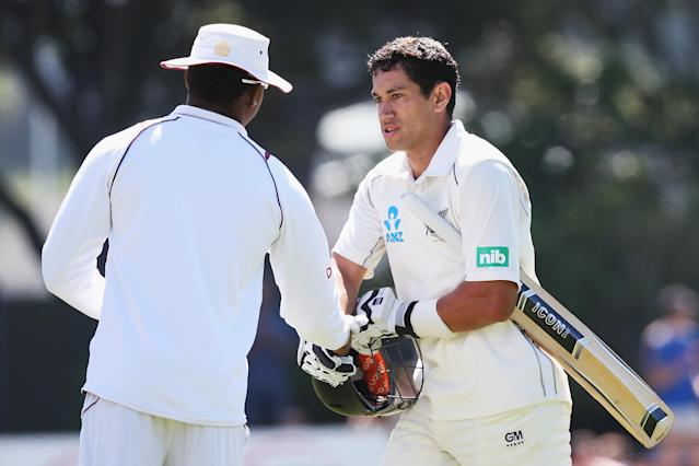 DUNEDIN, NEW ZEALAND - DECEMBER 04: Ross Taylor is congratulated during day two of the first test match between New Zealand and the West Indies at University Oval on December 4, 2013 in Dunedin, New Zealand. (Photo by Hannah Johnston/Getty Images)