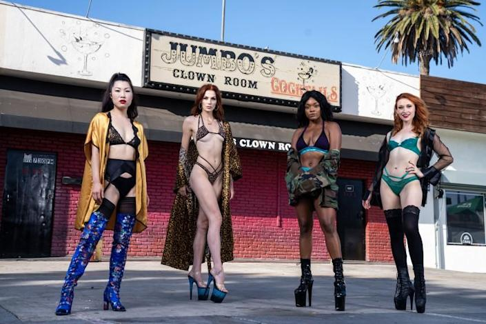 LOS ANGELES, CA - SEPTEMBER 21: Dancers Coco, Ono (Kayla Tange), Kitty (Kelly Vittetoe) , Danielle (Danielle Henderson), and Reagan (Megan Rippey) pose for a portrait in front of Jumbo's Clown Room on Monday, Sept. 21, 2020 in Los Angeles, CA. (Kent Nishimura / Los Angeles Times)