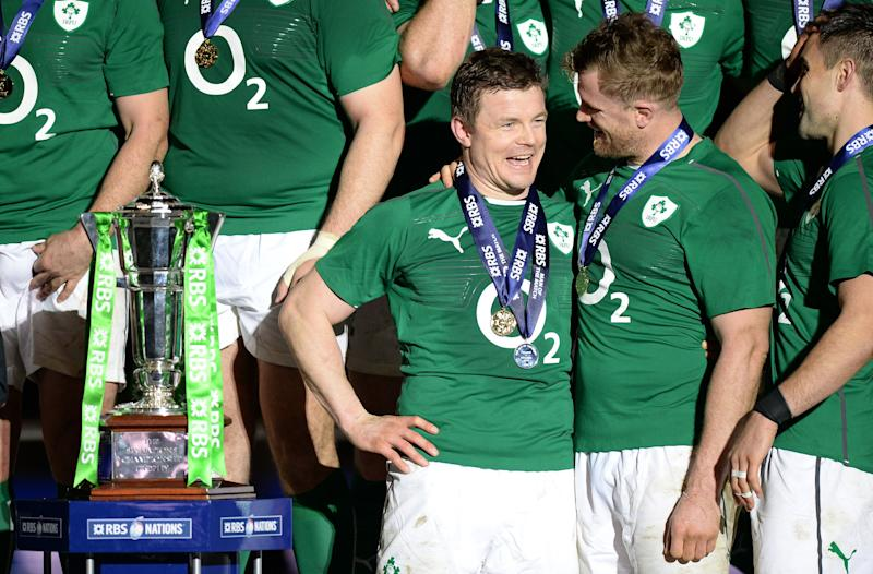 Ireland's Brian O'Driscoll is congratulated by team mate Jamie Heaslip afterthe Six Nations match at the Stade de France, Paris, France. (Photo by Andrew Matthews/PA Images via Getty Images)