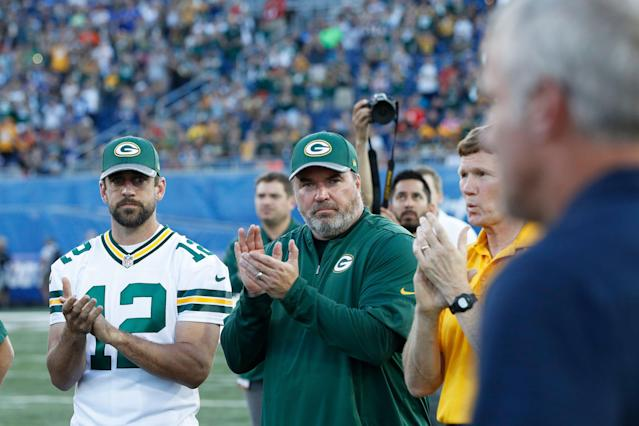 Aaron Rodgers acknowledges Hall of Famer Brett Favre as he was introduced after the Hall of Fame Game was cancelled due to poor field conditions in 2016. (Getty Images)