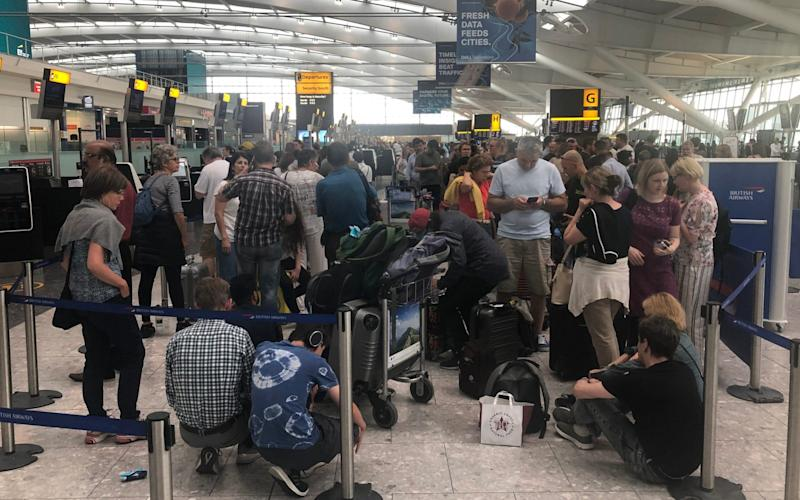 Queues in Terminal 5 at Heathrow airport as the UK's biggest airport,July 26, 2019. - PA