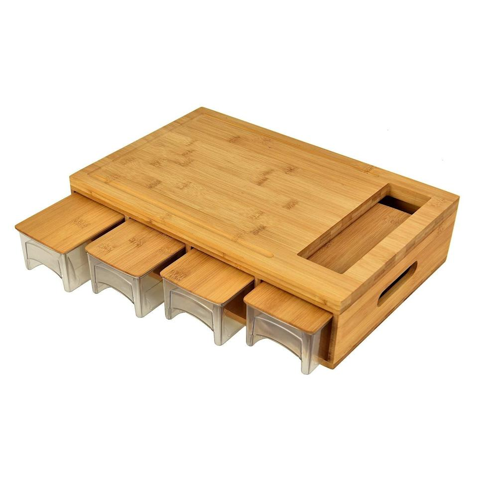 <p>You can cut up several things at once with this genius <span>Large Bamboo Cutting Board with Drawers</span> ($42).</p>
