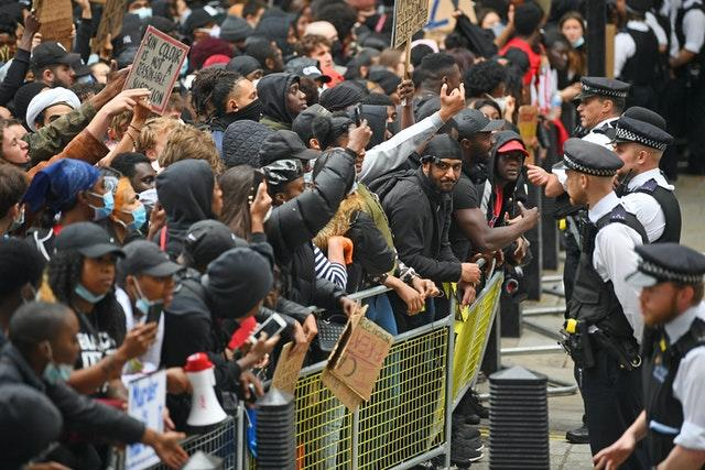 Protesters face police at the entrance to Downing Street