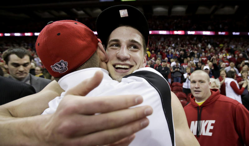 Wisconsin Ben Brust, right, celebrates with his brother, Jonathan, after Wisconsin defeated Michigan 65-62 in an NCAA college basketball game Saturday, Feb. 9, 2013, in Madison, Wis. Brust had team-high 14 points. (AP Photo/Andy Manis)