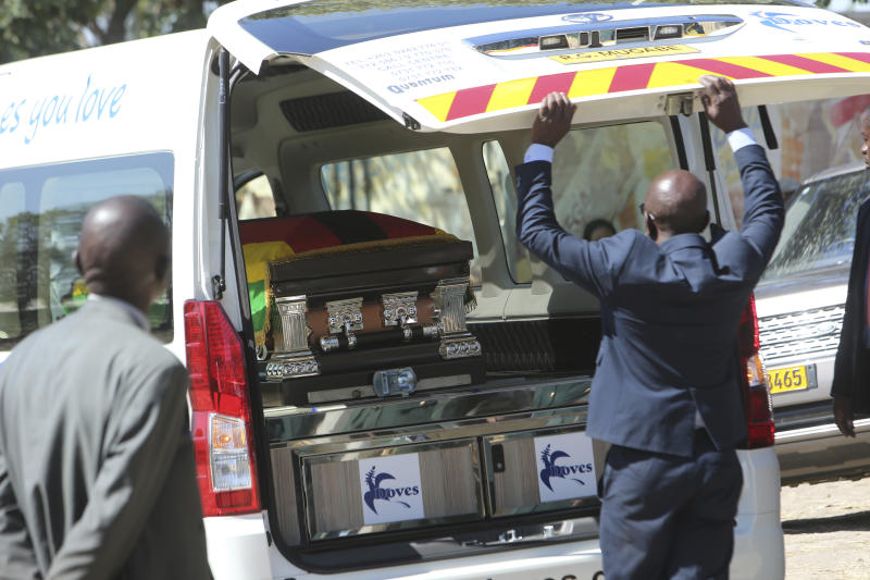 A van carrying the coffing of former Zimbabwean President Robert Mugabe is seen at his rural home in Zvimba, about 100 kilometers north west of the capital Harare, Saturday. Sept, 28, 2019. According to a family spokesperson Mugabe is expected to be buried at the residence after weeks of drama mystery and contention over his burial place. (AP Photo/Tsvangirayi Mukwazhi)