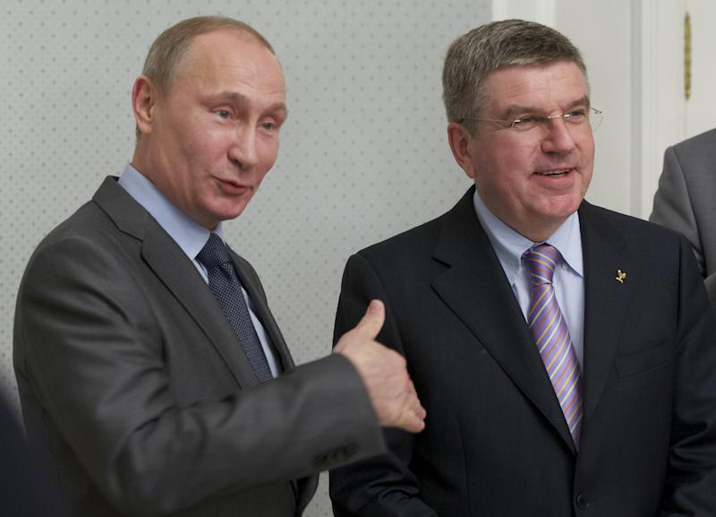 Russian President Vladimir Putin, left, and International Olympic Committee President Thomas Bach meet at the Bocharov Ruchei residence at the Black Sea resort of Sochi, southern Russia, Monday, Oct. 28, 2013. Making his first trip to Sochi since being elected head of the IOC last month, Bach met Monday with Russian President Vladimir Putin to inspect the host city. Bach told Putin he was deeply impressed with the amount of work Russia has done for the Feb. 7-23 games. (AP Photo/Alexander Zemlianichenko, Pool)