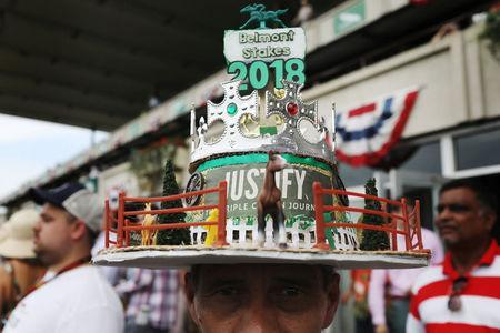 A racing fan wears a Justify themed hat before the 150th running of the Belmont Stakes, the third leg of the Triple Crown of Thoroughbred Racing, at Belmont Park in Elmont, New York, U.S., June 9, 2018. REUTERS/Mike Segar