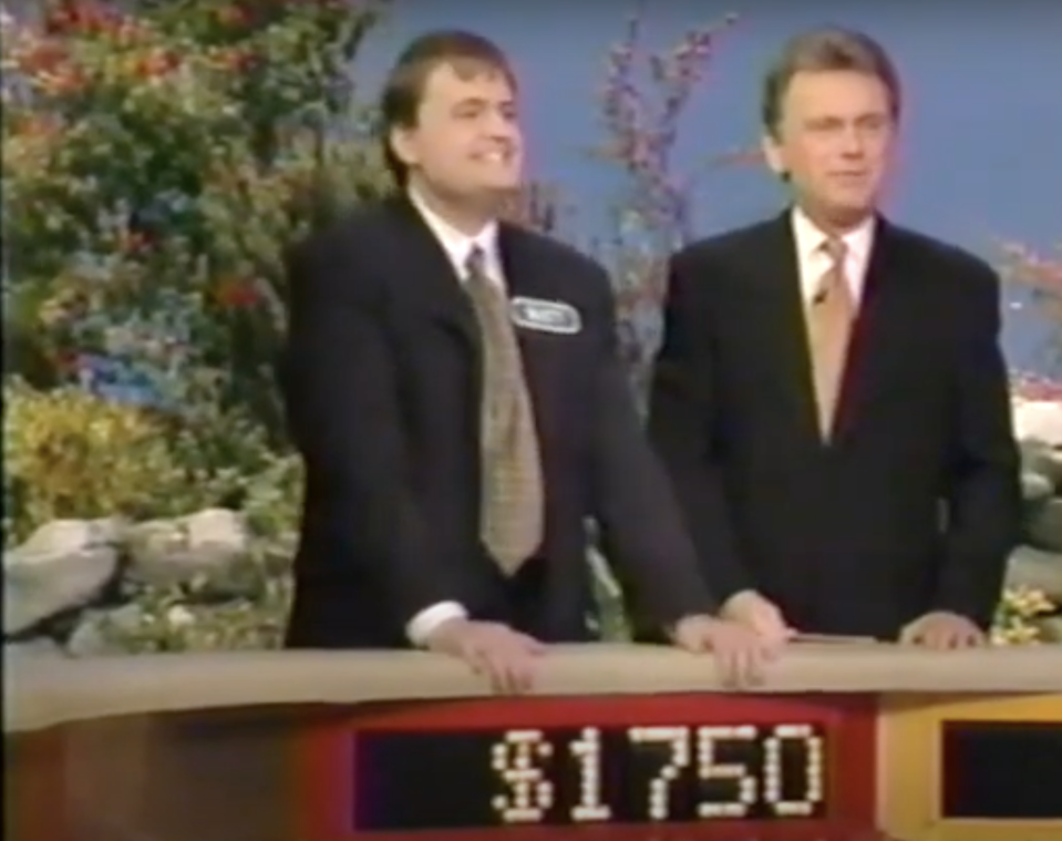 Matthew Fenwick appears on Wheel of Fortune next to host Pat Sajak in 1998.