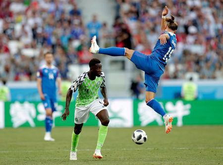 Soccer Football - World Cup - Group D - Nigeria vs Iceland - Volgograd Arena, Volgograd, Russia - June 22, 2018 Iceland's Rurik Gislason in action with Nigeria's Wilfred Ndidi REUTERS/Ueslei Marcelino
