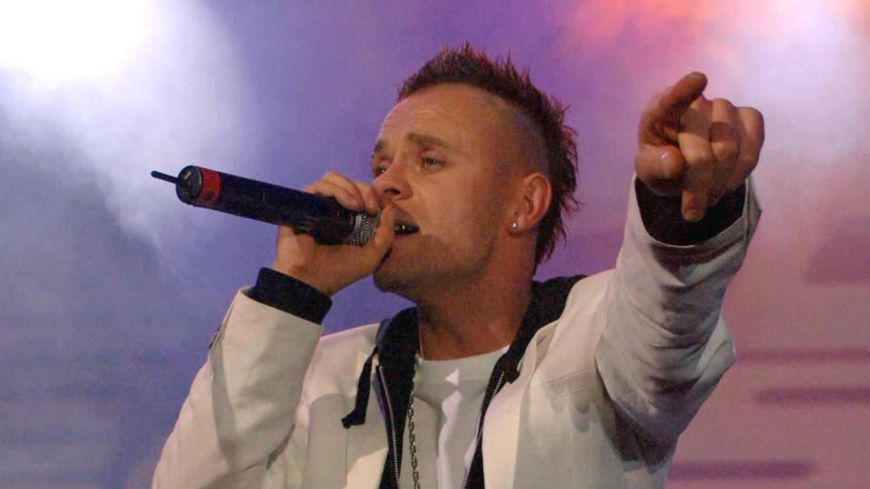 Brian Harvey performing on stage during an East 17 reunion gig in 2006. (Photo by Steve Parsons/PA Images via Getty Images)