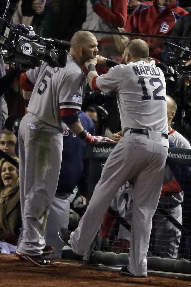 Boston Red Sox's Mike Napoli (12) pulls the beard of Jonny Gomes after Gomes hit a three-run home run during the sixth inning of Game 4 of baseball's World Series against the St. Louis Cardinals Sunday, Oct. 27, 2013, in St. Louis. (AP Photo/Charlie Riedel)