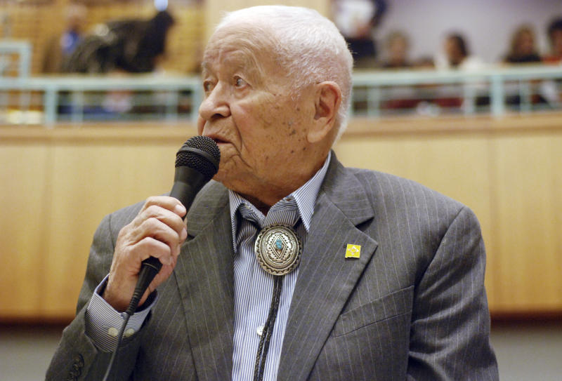 """FILE - In this Feb. 2, 2018, fle photo Democratic New Mexico state Sen. John Pinto talks about his career as a lawmaker on American Indian Day in the Legislature on in Santa Fe, N.M. Pinto joined the Senate in 1977 and is 92 years old. He was a Marine who trained as a Navajo code talker during World War II. His singing of the """"Potato Song"""" is an annual Senate ritual. (AP Photo/Morgan Lee, File)"""