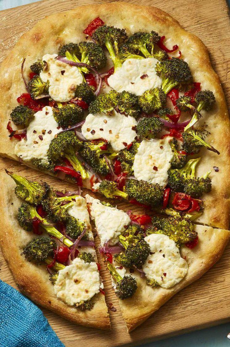 """<p>Fresh, light, and bright, this pizza is full of spring veggies, making it the perfect Mother's Day dinner.</p><p><a href=""""https://www.womansday.com/food-recipes/food-drinks/a26346231/roasted-broccoli-and-lemony-ricotta-flatbread-recipe/"""" rel=""""nofollow noopener"""" target=""""_blank"""" data-ylk=""""slk:Get the recipe for Roasted Broccoli and Lemony Ricotta Flatbread."""" class=""""link rapid-noclick-resp""""><em>Get the recipe for Roasted Broccoli and Lemony Ricotta Flatbread.</em></a></p>"""