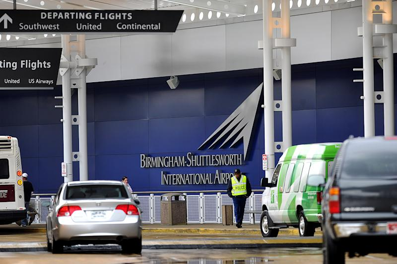 A flight information sign at the newly renovated Birmingham-Shuttlesworth International Airport in Birmingham, Ala., fell on a mother and her three children Friday afternoon, March 22, 2013, killing one child and injuring the mother and her two other children. (AP Photo/Tamika Moore, AL.com)  MAGS OUT