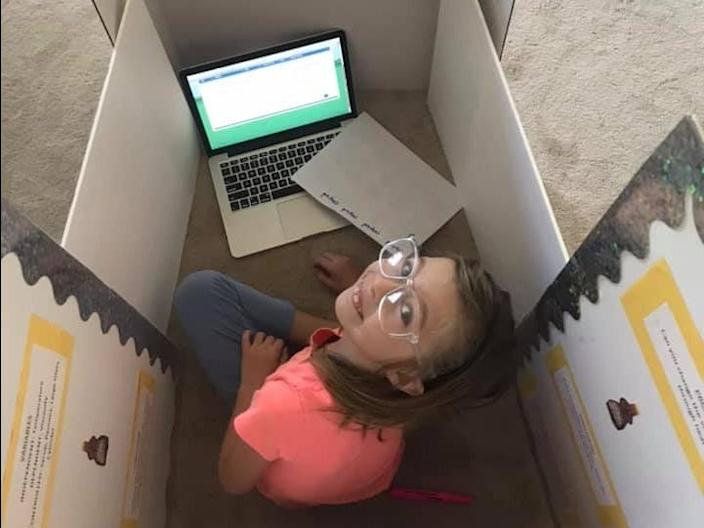 "After the ""incident,"" Foret Smith shared a photo of her daughter participating in her class while concealed by cardboard boxes."