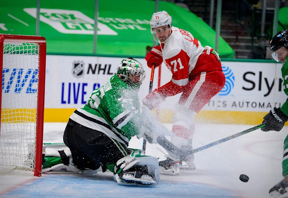 Stars goaltender Anton Khudobin stops a shot by Red Wings center Dylan Larkin during the first period in Dallas on Tuesday, Jan. 26, 2021.