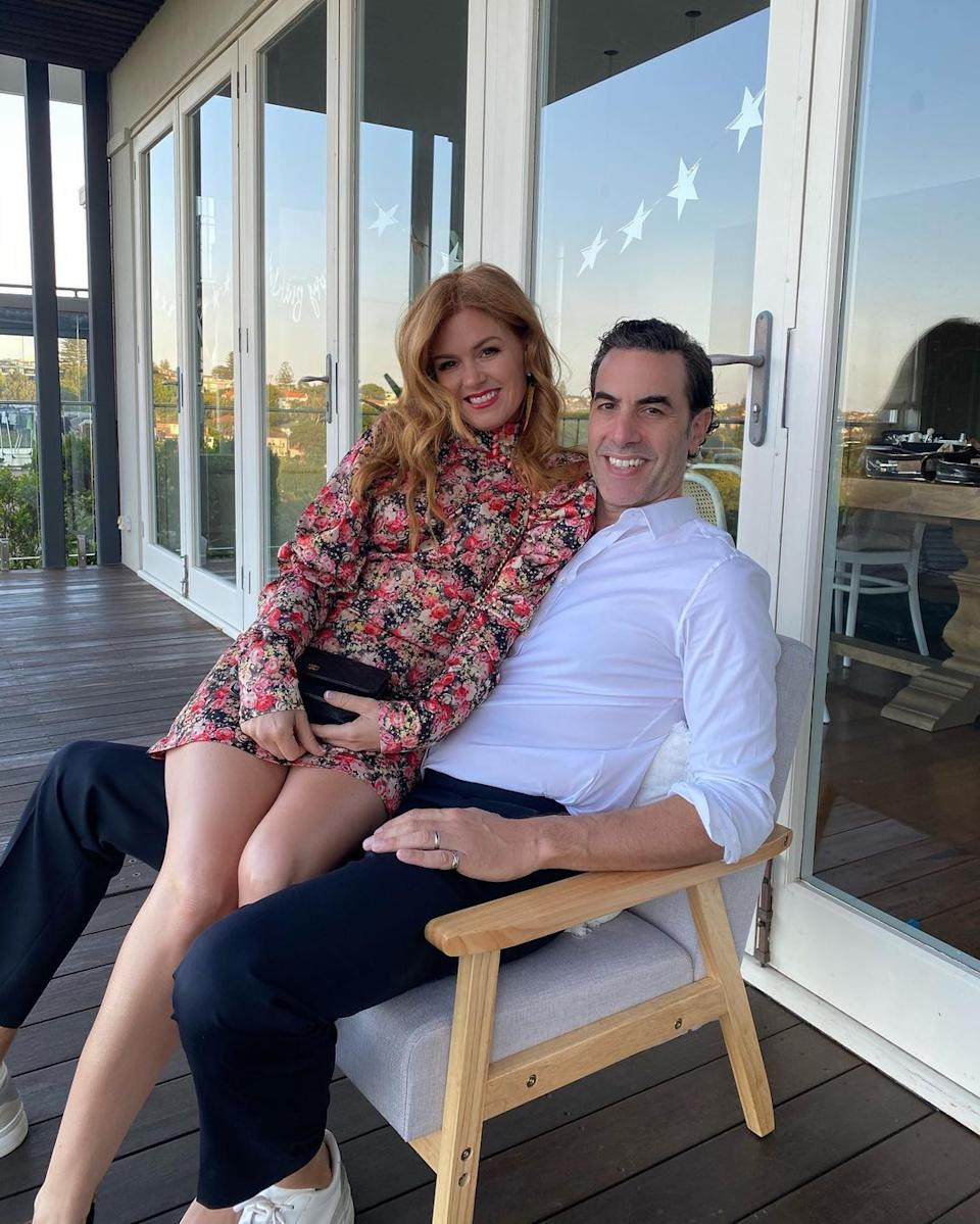 Australian actor Isla Fisher poses with her actor husband Sacha Baron Cohen on her 45th birthday