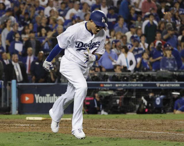Los Angeles Dodgers' Manny Machado reacts after popping out to end the 10th inning in Game 3 of the World Series baseball game against the Boston Red Sox on Friday, Oct. 26, 2018, in Los Angeles. (AP Photo/David J. Phillip)