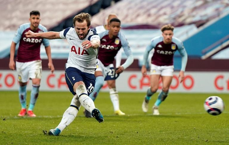 Spot on: Harry Kane (2nd left) sealed a much-needed win for Tottenham at Aston Villa