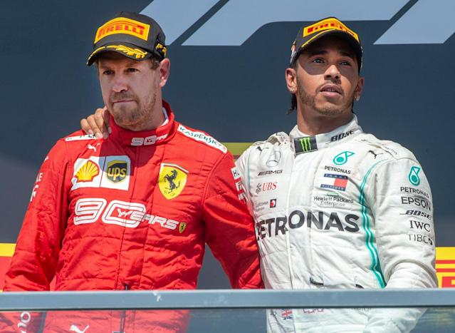 Hamilton, right, consoles Ferrari driver Sebastian Vettel. (Ryan Remiorz/The Canadian Press via AP)