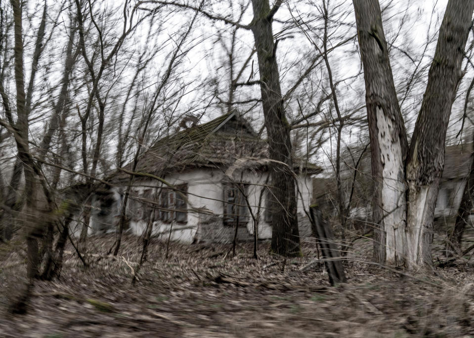 "Abandoned country houses are seen at the Chernobyl exclusion zone, Ukraine, Tuesday, April 13, 2021. The Ukrainian authorities are calling for the exclusion zone of objects to be included in the UNESCO World Heritage List, since the object is a unique place ""of interest to all mankind"". The Ministry of Culture of Ukraine has already taken steps to recognize the zone as a monument, which will attract more funding and tourists. (AP Photo/Evgeniy Maloletka)"