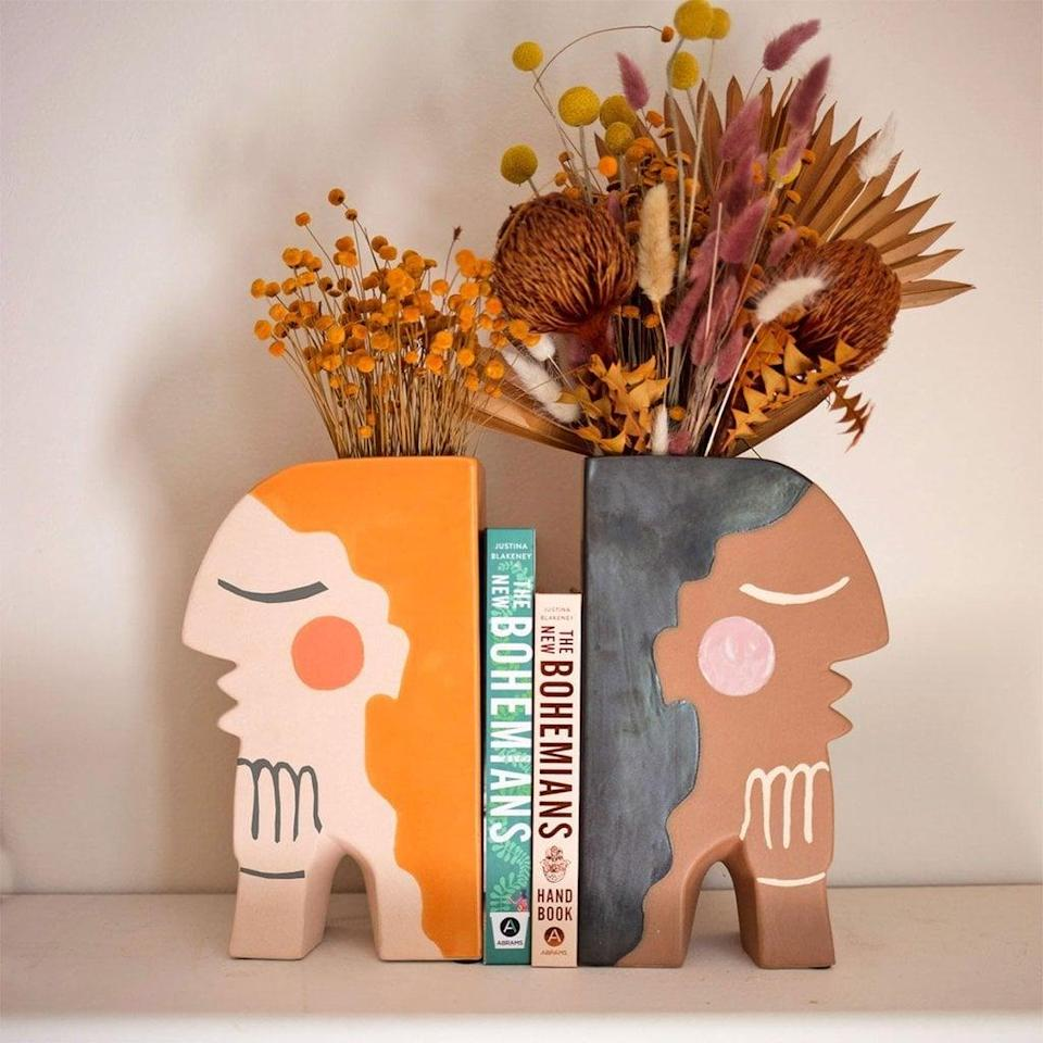 <p>This quirky <span>Face Bookend Vase</span> ($98 each) will brighten up their desk.</p>