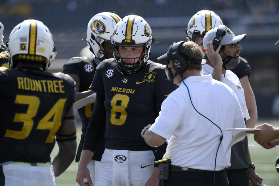 Missouri head coach Eliah Drinkwitz talks with quarterback Connor Bazelak (8) during the second half against LSU on Oct. 10, 2020, in Columbia, Missouri. (AP Photo/L.G. Patterson)