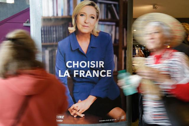 "<p>Two women pass an election poster for French far-right leader and presidential candidate Marine Le Pen which reads ""Choose France"" prior to an election campaign rally in Nice, southern France, Thursday April 27, 2017. After ""the battle of Whirlpool,"" when Marine Le Pen and Emmanuel Macron both went hunting for France's blue-collar vote at a threatened home appliance factory, the presidential candidates clashed over fish as Le Pen boarded a fishing trawler, in a return to more traditional campaigning on Thursday. (AP Photo/Claude Paris) </p>"
