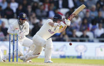England's Rory Burns plays a shot during the first day of third test cricket match between England and India, at Headingley cricket ground in Leeds, England, Wednesday, Aug. 25, 2021. (AP Photo/Jon Super)