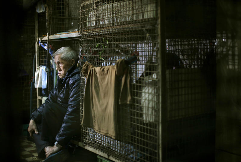In this Jan. 25, 2013 photo, 77-year-old Yeung Ying Biu sits inside his 1.5 square meter (16 square feet) cage, which he calls home, in Hong Kong. For many of the richest people in Hong Kong, one of Asia's wealthiest cities, home is a mansion with an expansive view from the heights of Victoria Peak. For some of the poorest, home is a metal cage. Some 100,000 people in the former British colony live in what's known as inadequate housing, according to the Society for Community Organization, a social welfare group. (AP Photo/Vincent Yu)
