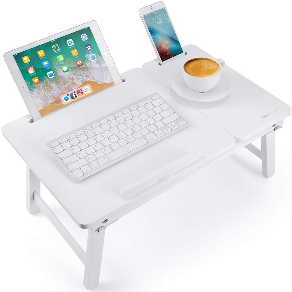 """<h2>Nnewvante Foldable Bamboo Laptop Desk</h2><br><br><strong>NNEWVANTE</strong> Foldable Bamboo Laptop Desk, $, available at <a href=""""https://amzn.to/33W86Sx"""" rel=""""nofollow noopener"""" target=""""_blank"""" data-ylk=""""slk:Amazon"""" class=""""link rapid-noclick-resp"""">Amazon</a>"""