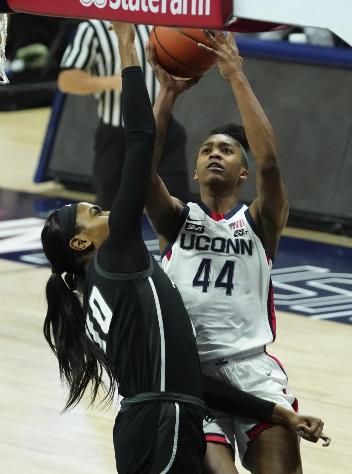 Connecticut forward Aubrey Griffin (44) drives to the basket against Providence forward Mary Baskerville (10) in the second half of an NCAA college basketball game at Harry A. Gampel Pavilion, Saturday, Jan. 9, 2021, in Storrs, Conn. (David Butler II/Pool Photo via AP)