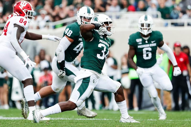 Michigan State linebacker Antjuan Simmons celebrates a tackle against Indiana during the first half at Spartan Stadium in East Lansing, Saturday, Sept. 28, 2019.