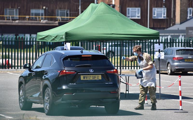 A car stops at a mobile coronavirus testing facility at Southend Airport, in Essex - John Keeble/Getty Images Europe
