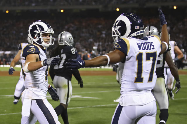 Los Angeles Rams wide receiver Cooper Kupp, left, is congratulated by teammate Robert Woods (17) after scoring a touchdown during the second half of an NFL football game against the Oakland Raiders in Oakland, Calif., Monday, Sept. 10, 2018. (AP Photo/Ben Margot)