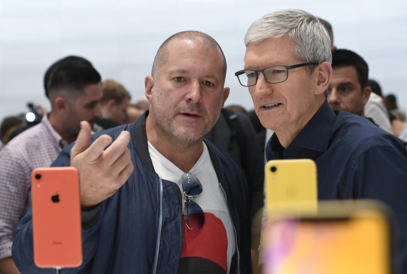 CUPERTINO, CALIFORNIA - SEPTEMBER 12: Apple chief design officer Jony Ive (L) and Apple CEO Tim Cook inspect the new iPhone XR at the Steve Jobs Theater on September 12, 2018 in Cupertino, California. Apple released three new versions of the iPhone and an updated Apple Watch in Cupertino on Wednesday. (Photo by Qi Heng/VCG via Getty Images)